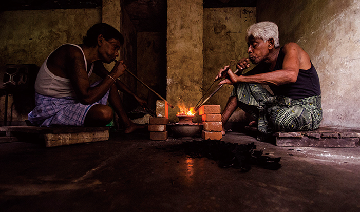 Treaters practicing the ancient art of blowpipe heating in Ratnapura, Sri Lanka. As described by al Beruni ca. 1045 AD, the temperatures reached by this technique exceeds that of the melting point of gold (1064°C). From Hughes et al., 2014. Photo: Wimon Manorotkul, 2012.