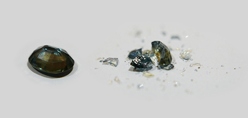 A basalt–related sapphire (left) that was heat treated by traditional methods was subjected to a hammer test, which caused it to break into many fragments (right). Photo: SSEF